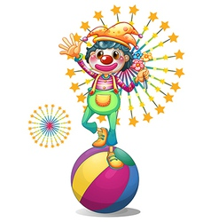 A female clown above the colorful ball vector image vector image