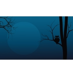 Silhouette of owl in tree halloween vector