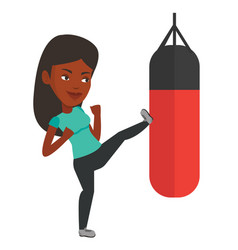 Woman exercising with punching bag vector