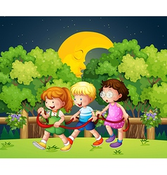 Three kids outdoor walking in the middle of the vector image