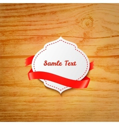 Label with ribbon over wooden background vector
