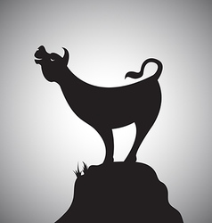 Cow standing on the rocks vector