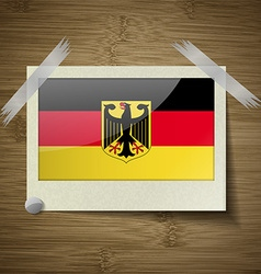 Flags germany at frame on wooden texture vector