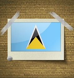 Flags saint luciaat frame on a brick background vector