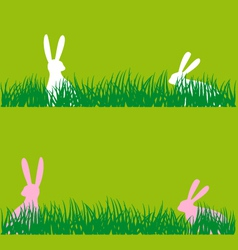 Easter bunnies in grass vector