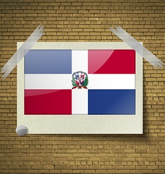 Flags dominican republic at frame on a brick vector