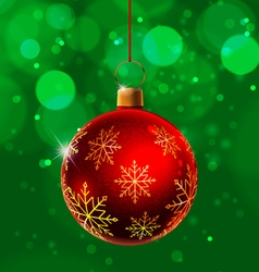Red christmas ball on green background vector