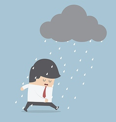Depressed businessman walking in the rain vector