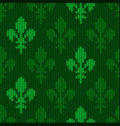 Knitted woolen heraldic lily of green tones vector