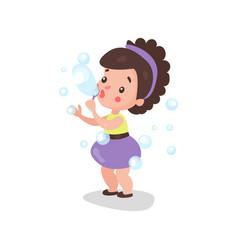 sweet cartoon brunette little girl blowing and vector image