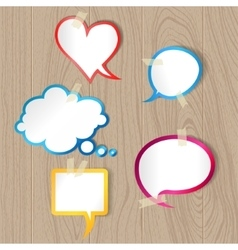 Speech bubbles on wood texture vector