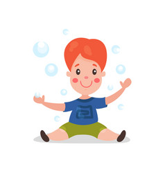 cute cartoon redhead little boy sitting on the vector image vector image
