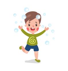 cute cartoon smiling little boy having fun playing vector image vector image