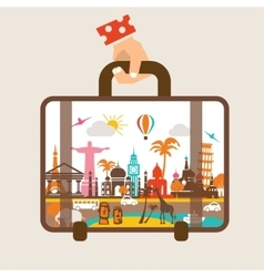 hand holding luggage travel around the world vector image vector image