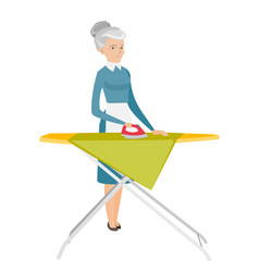 Caucasian maid ironing clothes on ironing board vector