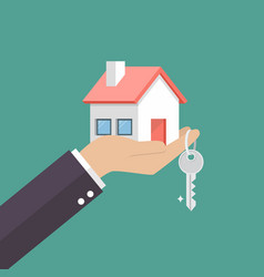 hand holding home in palm and key on finger vector image