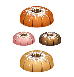 Four bundt cake topped with sugar glaze and walnut vector