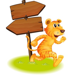 A tiger running and the empty signboards vector image