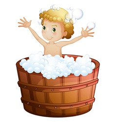 A young boy taking a bath vector image vector image