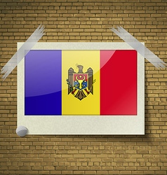 Flags Moldovaat frame on a brick background vector image