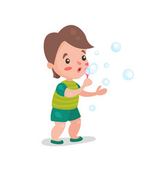 cute cartoon little boy blowing and playing with vector image vector image