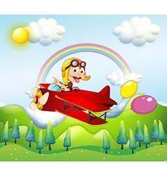 A monkey riding on a red plane with two balloons vector