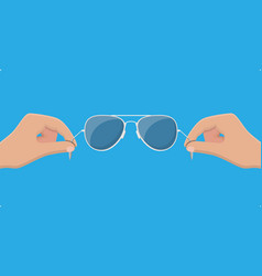 aviator sunglasses in hand protective eyewear vector image
