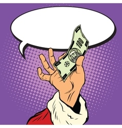 Hand of Santa Claus with Christmas money vector image