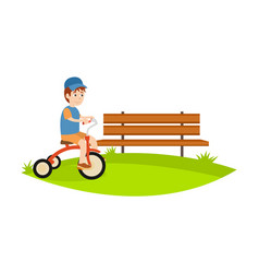 Little boy in park riding bike relax have fun vector
