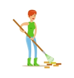 Woman raking the garbage during clean up vector