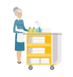 Senior chambermaid pushing cart with bed clothes vector