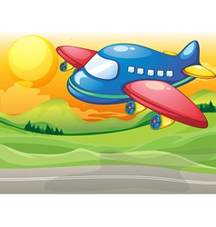 A blue airplane above the road vector