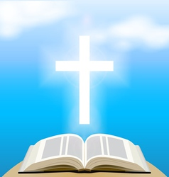 Bible and shining cross over blue sky vector image