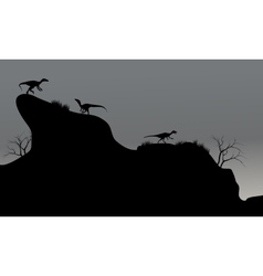 eoraptor in cliff silhouette at night vector image vector image
