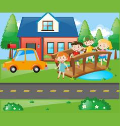 Children standing on the bridge in front of house vector