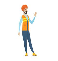 Young hindu builder waving his hand vector