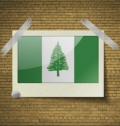 Flags norfolk islandat frame on a brick background vector