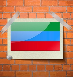 Flags Dagestan scotch taped to a red brick wall vector image