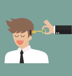 man holding a key unlocking businessman mind vector image