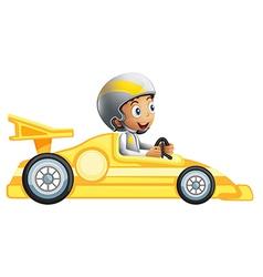 A boy riding in a yellow racing car vector image vector image