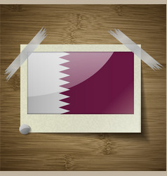 Flags qatar at frame on wooden texture vector