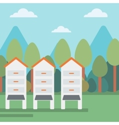 Background of beehives in meadow vector image