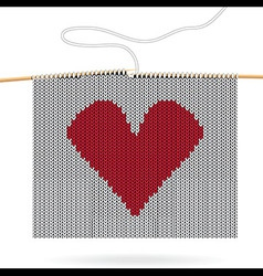 Knitted heart on needles vector