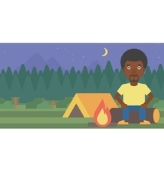 Man sitting on log in the camping vector