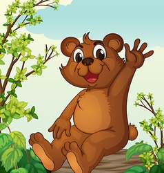 A bear sitting on a wood vector image