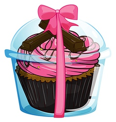 A cupcake with a pink icing vector