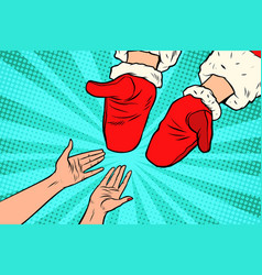 Hand of santa claus and women vector
