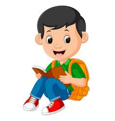 kids boy reading book vector image