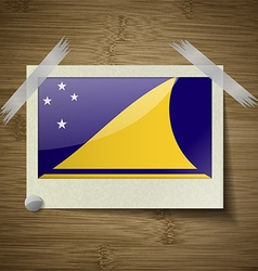 Flags tokelau at frame on wooden texture vector