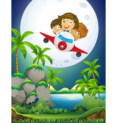 Children riding airplane over the park vector